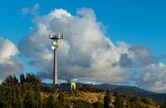 hill top transmission tower - stock photo