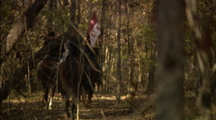 Soldier waving signal flag on horse Stock Footage