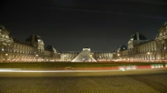 Le Louvre in Paris France time lapsed at night with traffic Stock Footage