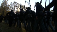 Soldiers walking through wooded area Stock Footage
