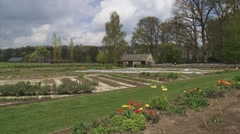 Traditional kitchen garden in spring - pan flower beds Stock Footage