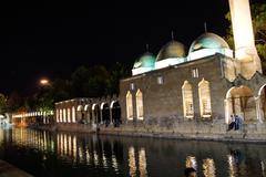 night reflections of halil rahman cami - stock photo