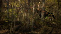Officer riding through woods Stock Footage