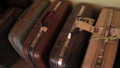 1960's 70's vintage suitcases in storage Stock Footage