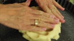 Woman preparing a fresh fruit tart desert crust Stock Footage