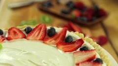 a baker preparing fresh berry fruit tart desert crust - stock footage