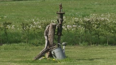 Nostalgic water pump zoom out traditional kitchen garden Stock Footage
