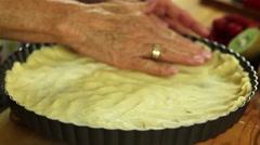 A woman preparing fresh fruit tart desert crust Stock Footage
