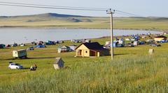 Tourist camp on the shore of Belyo lake (Khakassia) Stock Photos