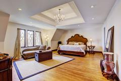 bright luxury bedroom with design ceiling - stock photo