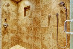 granite tile wall trim in luxury bathroom - stock photo