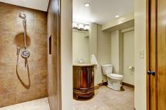 Stock Photo of bathroom interior with carved wood vanity cabinet