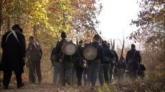 Union Soldiers walking through wooded area Stock Footage