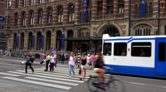 Tram in front of Magna Plaza Amsterdam Stock Footage