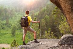 backpacker go up mountain - stock photo