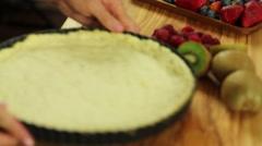 A lady preparing a fresh fruit tart desert crust Stock Footage