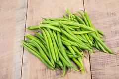 Fresh green beans on table Stock Photos