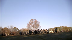 Soldiers gathered in field Stock Footage