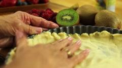 Woman preparing fresh fruit tart desert crust Stock Footage