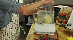 Woman preparing a fresh fruit tart desert Stock Footage