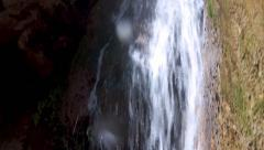 Exotic Waterfall runs through Mediterranean valley. Downward Camera Movement Stock Footage