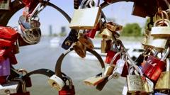 Locks mounted on bridge fence. strong love partnership symbol  Stock Footage