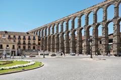 Aqueduct of segovia on plaza del azoguejo Stock Photos