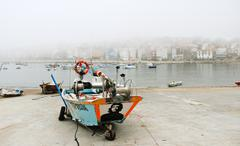Stock Photo of boat with portrait of che guevara in port in fog