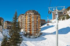 ski lift and view of avoriaz town in alps, france - stock photo