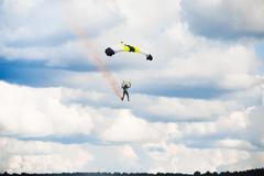 Man landing after parachuting jump Kuvituskuvat