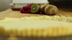 Lady preparing a fresh berry fruit tart desert crust rack focus Stock Footage