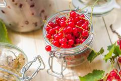 preparation products processed fresh colorful summer fruits jars - stock photo