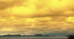 4k ocean dusk sunset dawn sky&coastal coast yellow cloud cloudscape timelapse. Stock Footage