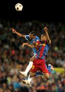 Kale Uche(L) of Almeria fights with Keita(R) of Barcelona Stock Photos