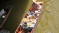High angle shot of a vendor in a boat on the Damnoen Saduak floating market Stock Footage
