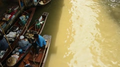 Beautiful shot of a vendor rowing down the floating market Stock Footage