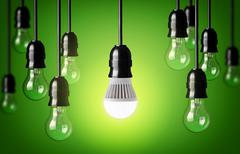 Stock Photo of led bulb and simple light bulbs.green background