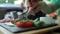 Man eating grilled meat with vegetables. Stock Footage