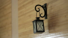 Beautiful candle holder hanging on wooden wall Stock Footage