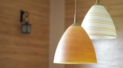 two beautiful chandeliers on the background of wooden wall - stock footage