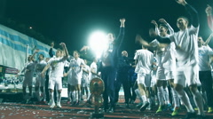 Soccer players celebrate the victory Stock Footage