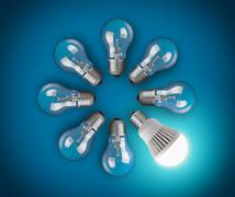 idea concept with circle of light bulbs and glowing led bulb - stock photo