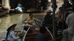 Vendors and tourists floating around at the Damnoen Saduak floating market Stock Footage
