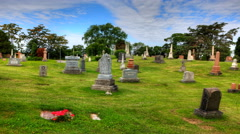 4K UltraHD Timelapse view in a cemetary with blue skies - stock footage