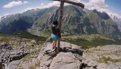 Hiker on top of a mountain peak Stock Footage