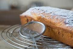 powdered sugar applied on marble cake - stock photo