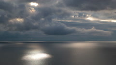 Beam of light through the clouds over the Atlantic Ocean, Iceland Stock Footage