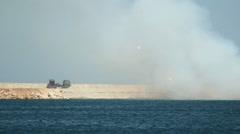 Rocket salvo - rocket artillery attack on the coast Stock Footage