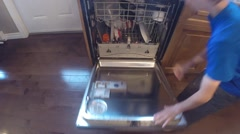 Small boy unloading the dishwasher Stock Footage