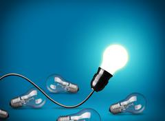 Idea concept with glowing light bulb Stock Photos
